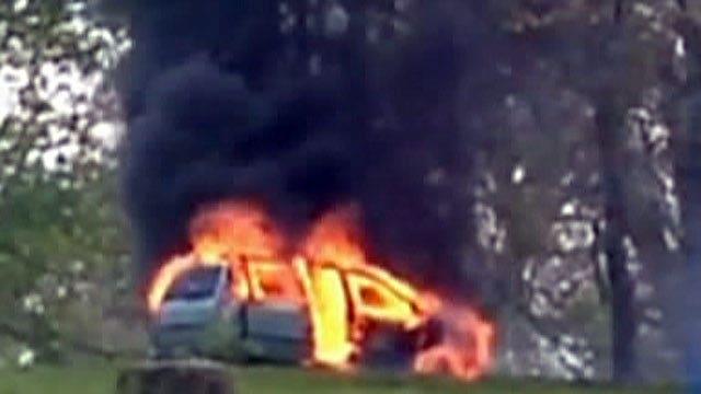 Car fire traps family in drive-thru lion safari