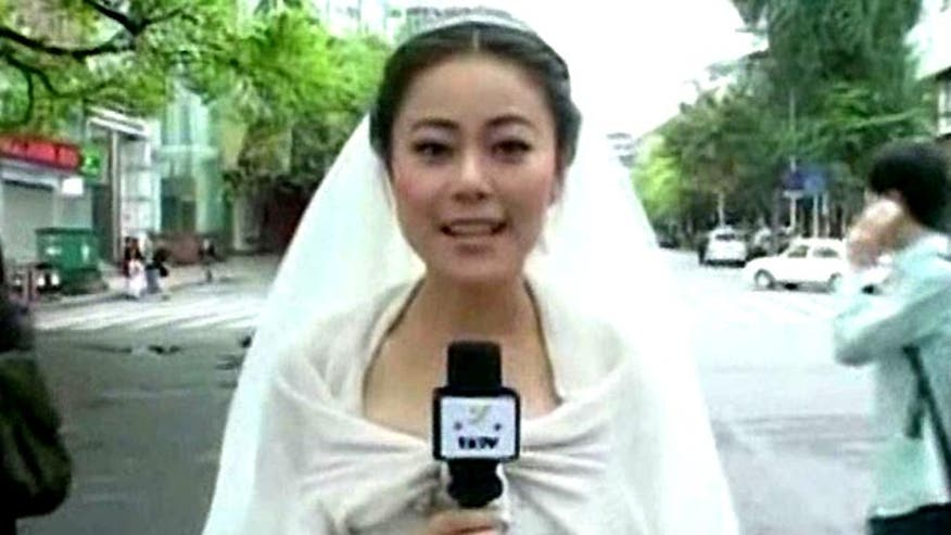 Reports earthquake news in her dress