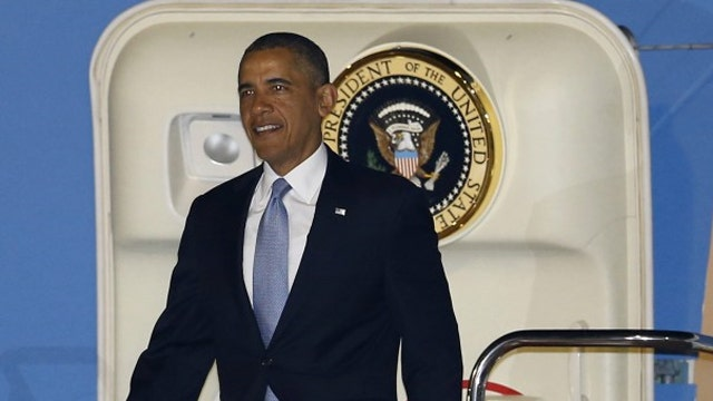 Obama arrives in Japan as US troops are sent to Europe