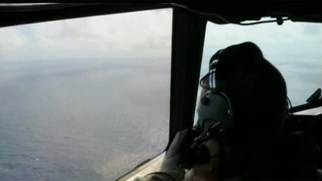 Possible debris from Flight 370 washes ashore