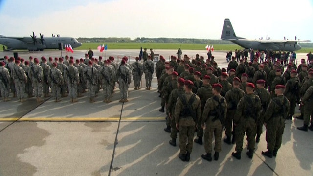 US sends message to Putin as troops arrive in Poland