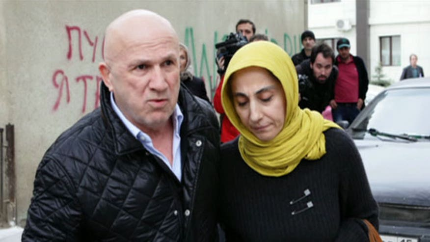 Investigators turn to Boston bombing suspect's widow and parents for answers, but the mother faces shoplifting charges