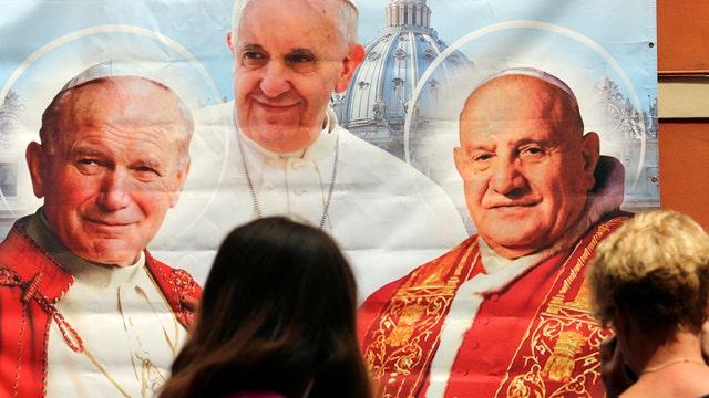 What makes Popes John XXIII and John Paul II saints?