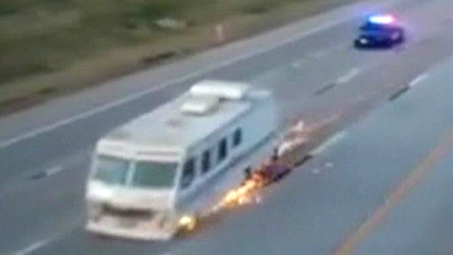 Sparks fly as RV leads swarm of cop cars on high-speed chase