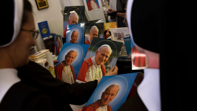 Will dual canonizations reconcile Catholic Church?