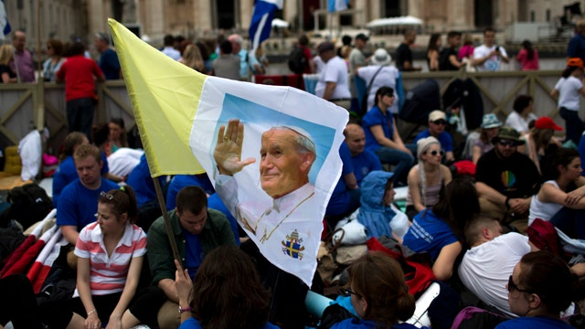 Millions gather in Vatican City to witness history