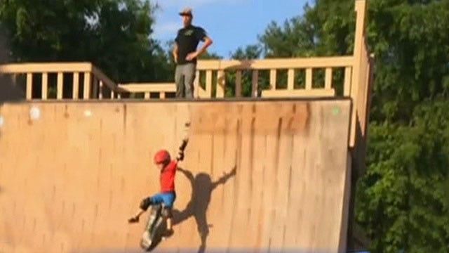 Dad caught kicking kid down half-pipe to teach skateboarding
