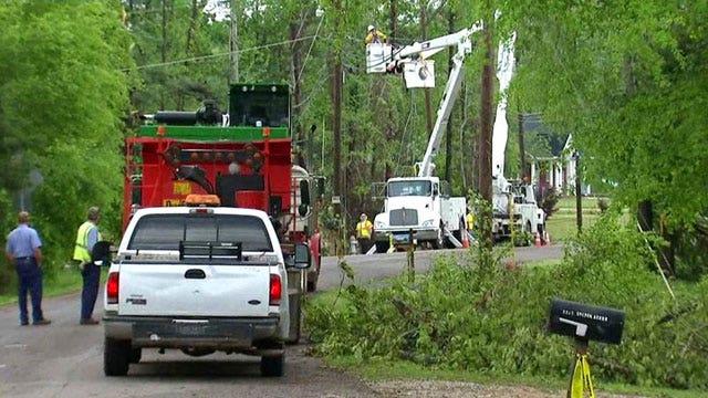 Alabama begins cleanup; massive flooding in Florida