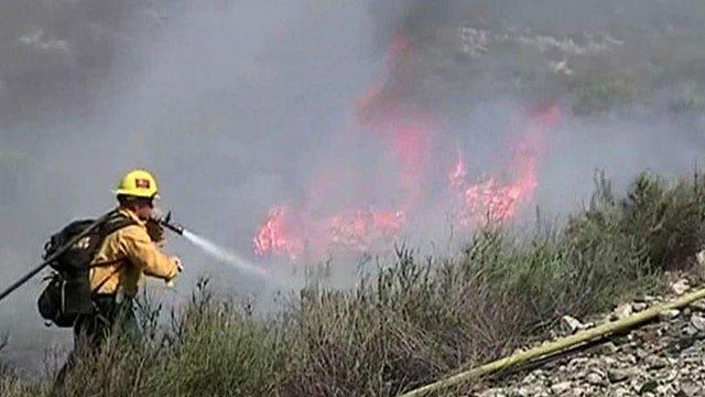Firefighters battle wildfire in foothills near LA