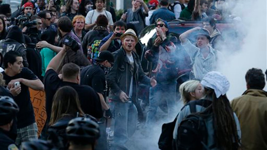 Protesters clash with police in downtown Seattle