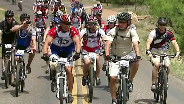 President Bush bikes with Wounded Warriors