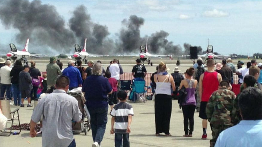 No spectators hurt, pilot's condition unknown