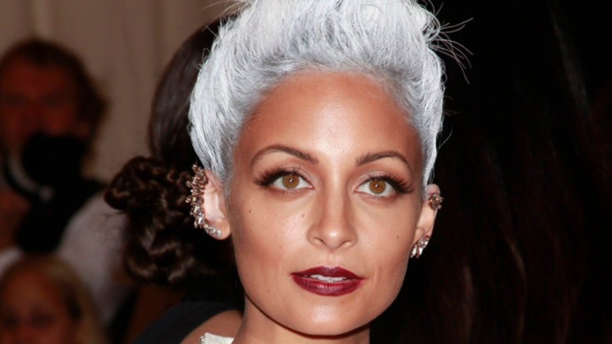 Rihanna tweeted Nicole Richie makes her want to throw up, but that's a good thing.