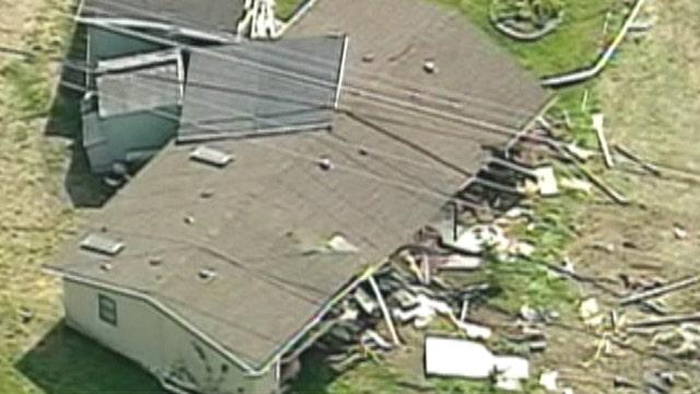 Washington man damages 4 homes in bulldozer rampage, authorities say