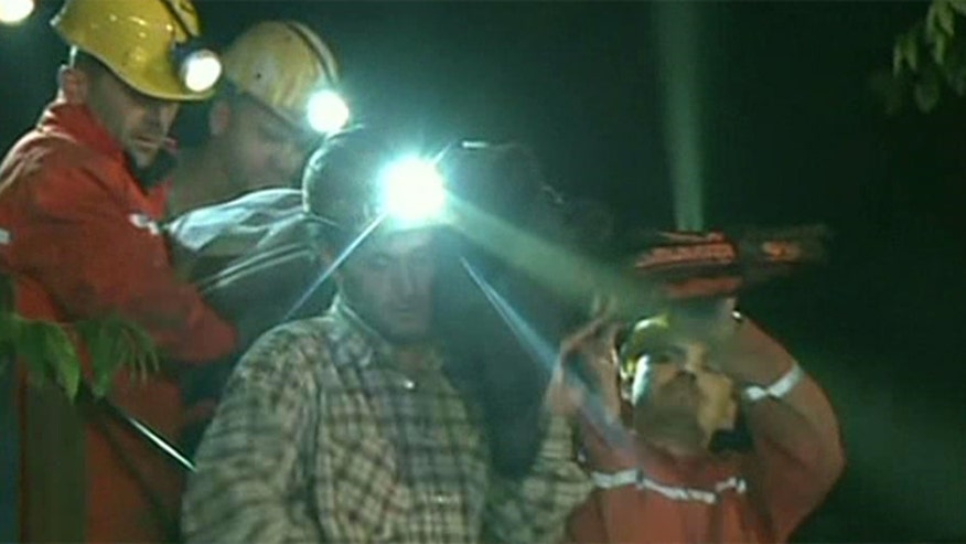 Rescuers race against time to save trapped miners