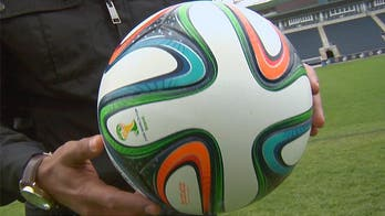 Players test out the official World Cup 2014 soccer ball