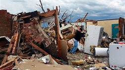 Does the idea of the existence of a loving God get swept away in the wake of tornadoes or hurricanes like a tin building or mobile home?
