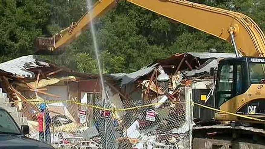 Workers demolish houses neighboring home where 37-year-old Jeff Bush lost his life during February's tragedy