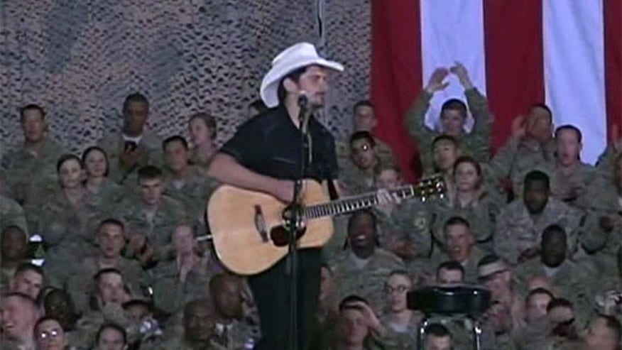 Brad Paisley performs for the troops as part of Obama's surprise visit to Afghanistan
