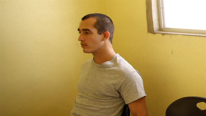 Sgt. Andrew Tahmooressi says the prison guards hit him in the face and stomach