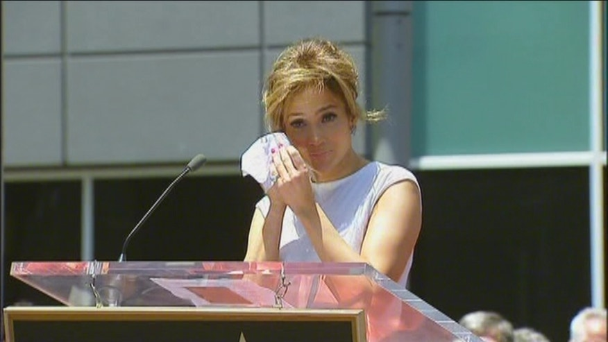 JLO gets emotional as she receives a star on the Hollywood Walk of Fame.