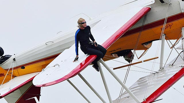 Why do wing-walkers take the big risk?