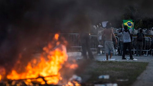 Condoning violence? Union boss endorses Brazilian riots