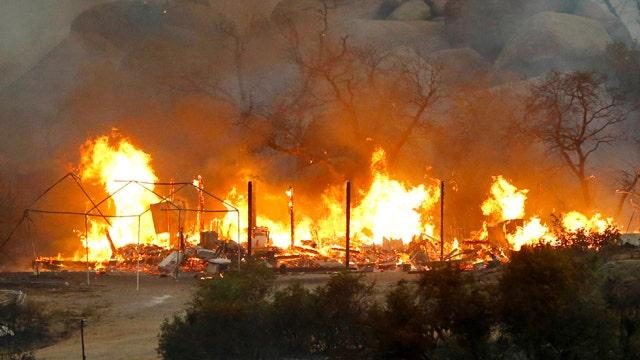 Heat wave fuels deadly Arizona wildfire