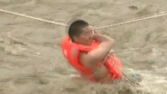 Rescuers rush to save man trapped on small island in China