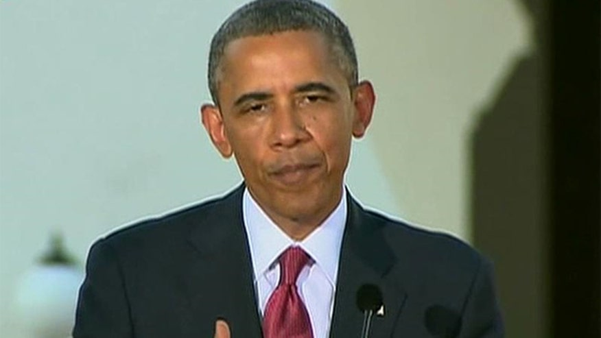 Obama tries to ease tensions over probe allegations