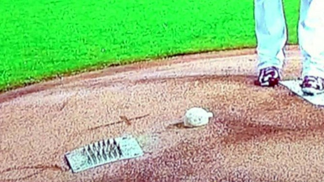 """Cross erased from mound in memory of Stan """"The Man"""" Musial"""