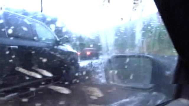 Driver loses control of car during flash flood