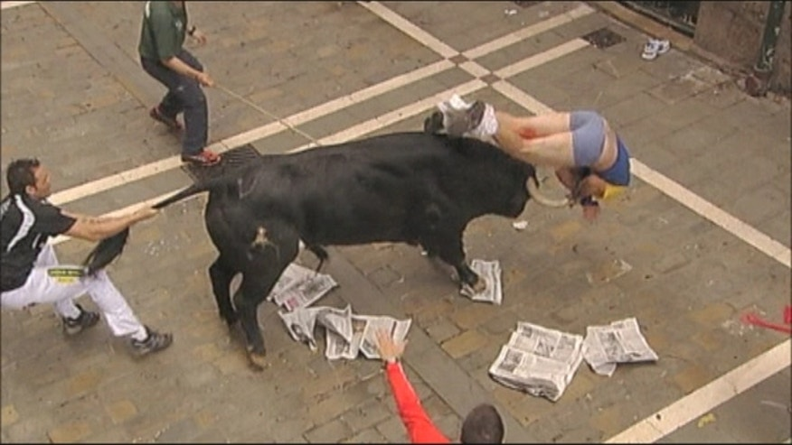 Dramatic scenes as loose bull causes panic on streets, three gored.