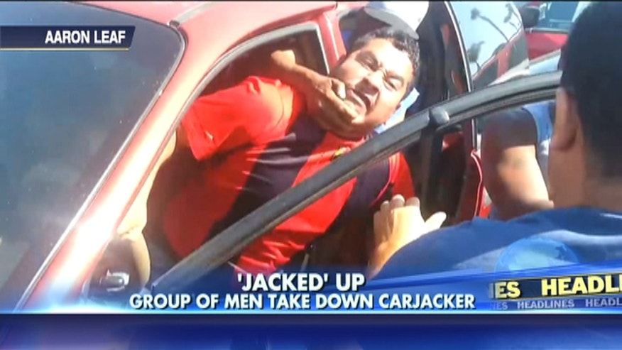 An attempted carjacking was foiled after a group of men jumped the suspected car thief - while getting the incident on video.