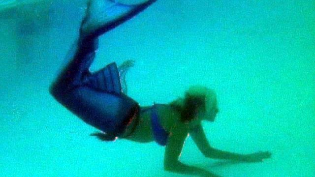 Florida community pool: no mermaids allowed