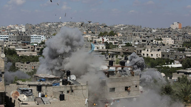 Israel warns Gazans to leave homes as Hamas urged to accept cease-fire