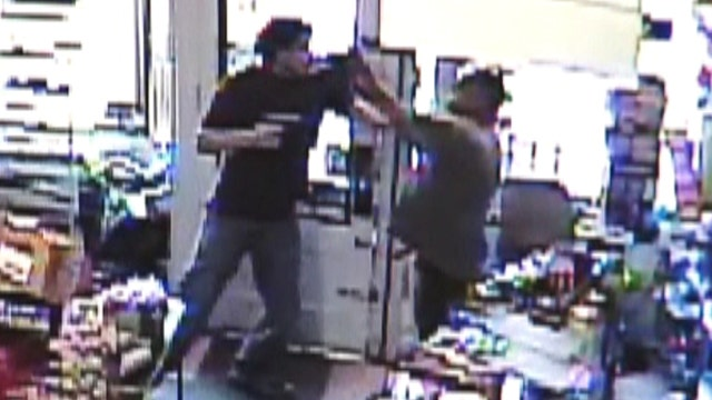 Convenience store clerk fights off robbery suspect