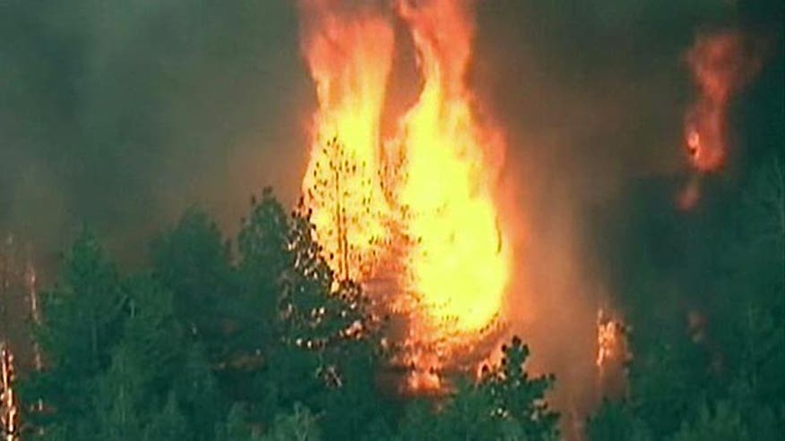 Firefighters try to contain mountain fire