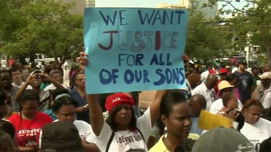 Thousands gather to peacefully protest outcome of the Zimmerman trial