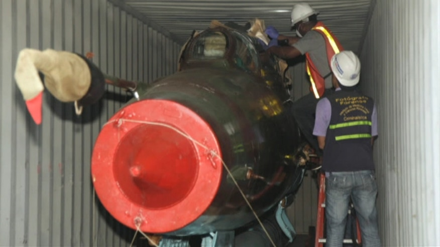 Investigators looking into a Cuban weapons cache found two Mig-21 jets; 27 containers being searched.