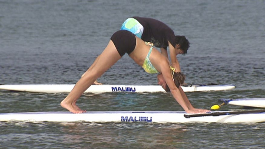 Paddleboarding is one of the hottest water sports of the summer, and now it's helping yoga students take their practice to another level