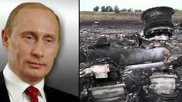 Ukraine clashes intensify as police team abandons second attempt to inspect MH17 crash site