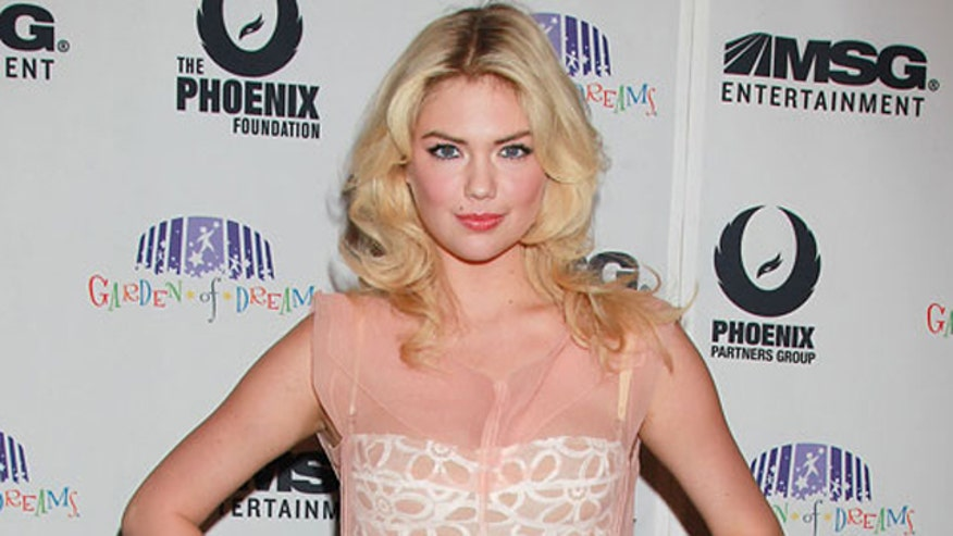 Kate Upton works hard to keep her figure...and so does her trainer.