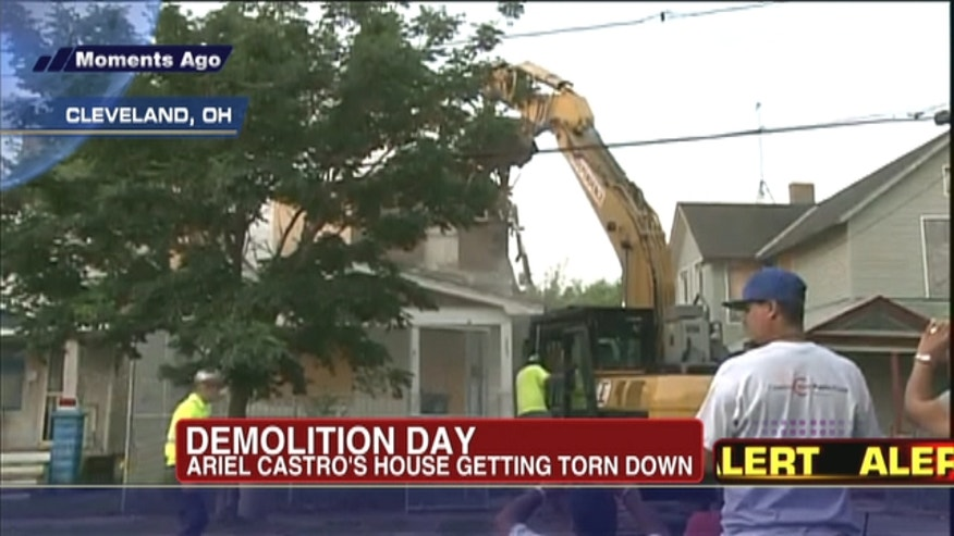 The house is being torn down as part of a deal that spared Ariel Castro a possible death sentence. He was sentenced last week to life in prison plus 1,000 years.