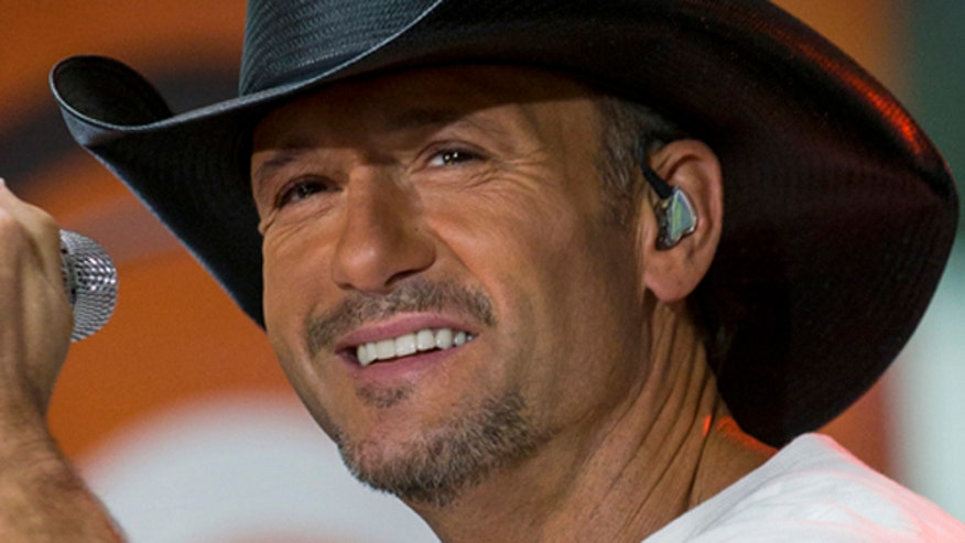 Tim McGraw and the woman he 'swatted' make up
