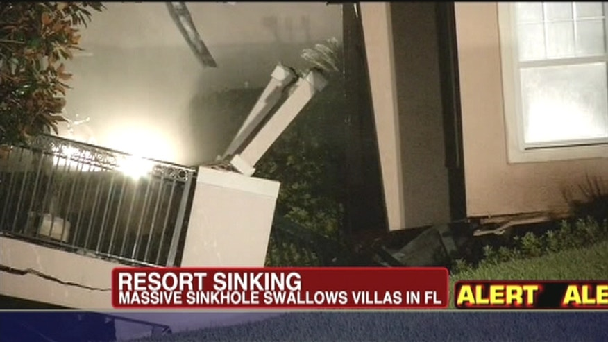 A sinkhole caused a section of a central Florida resort villa to partially collapse, while another section of the villa was sinking.