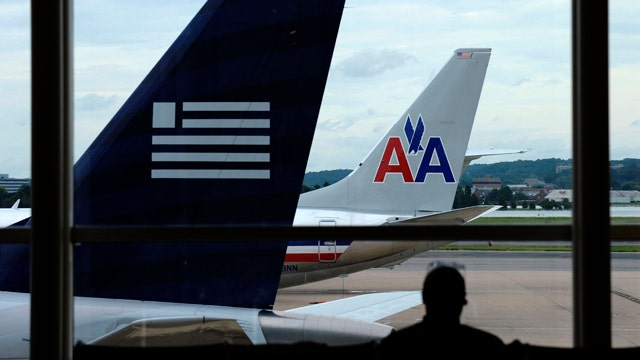 DOJ sues American Airlines, US Airways over merger