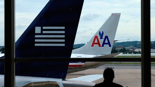 Justice Department sues American Airlines, US Airways