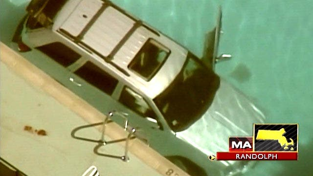 Mass. woman dies after SUV crashes into pool