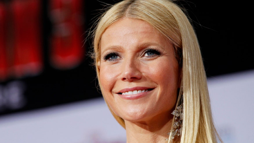Gwyneth Paltrow shows off her bod on a trampoline; celeb photogs who take yearbook pics; and, meet a shark's best friend.